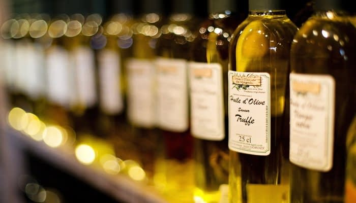Bottles of olive oil infused with truffles on a shelf