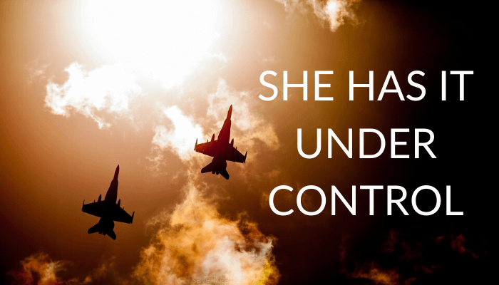 Two fighter jets in the clouds with text that says She has it under control