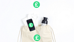 Silver drinks bottle and white towel poking out of ream gym bag on white background