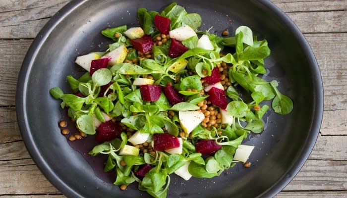Apple or pear and beetroot salad with pine nuts and lambs lettuce