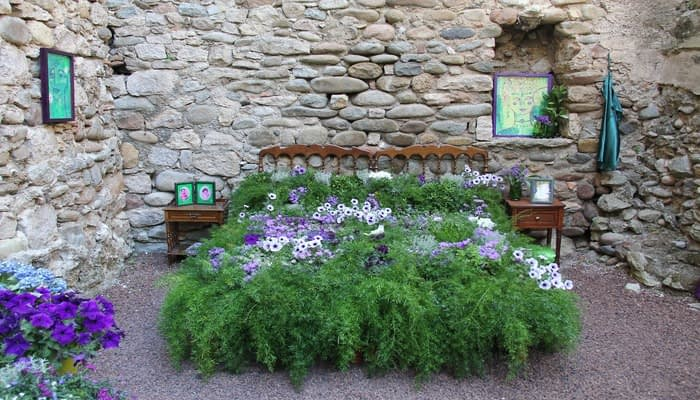 Double bed made from flowers outside in a courtyard
