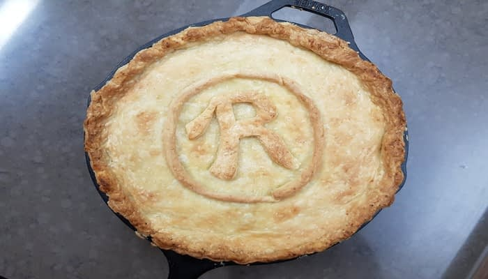 Pastry pie decorated on top with a capital R