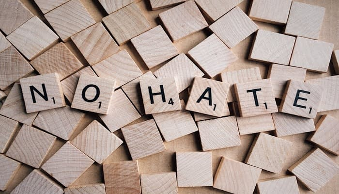 scrabble tiles spell out no hate