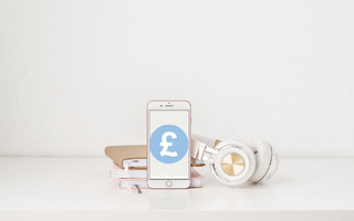 headphones and iphone and notebooks rose gold