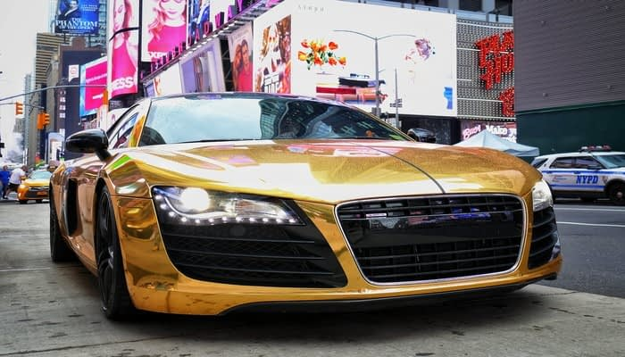 Gold sports car on Broadway in New York