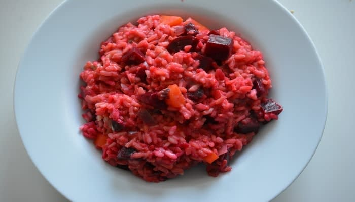 Beetroot risotto in white bowl