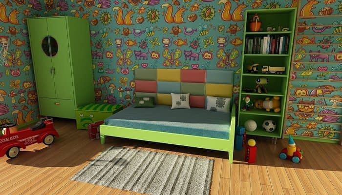 Toy room with green furniture and squirrels and butterflies on the wallpaper