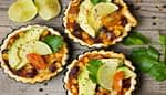 Avocado, black beans and sweetcorn in 3 tarts on a table